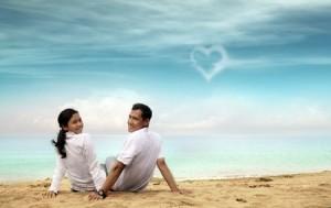 Happy asian couple at beach